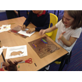 Making cave paintings
