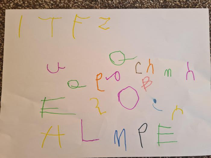 Marnie having a go at her letters