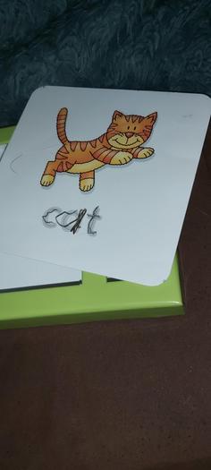 Leo practising his letters