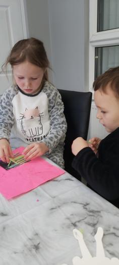 Leo making the three little pigs crafts