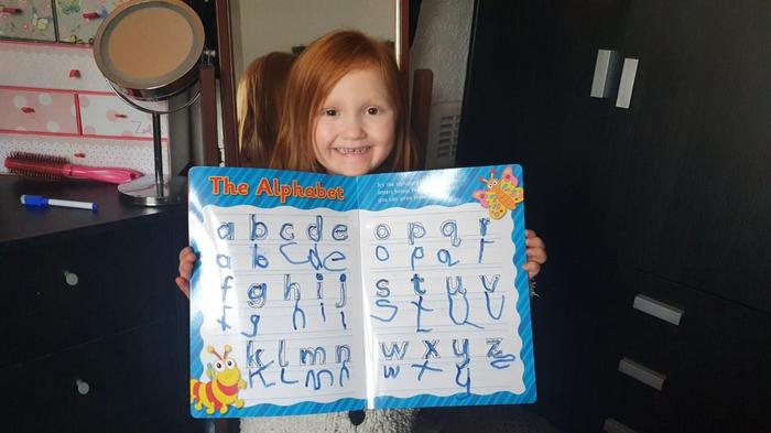 Maggie practising her letters