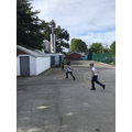 Boys chased hoops.