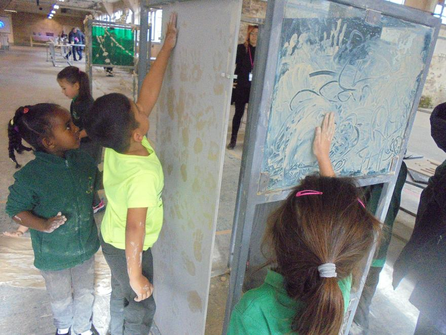 Exploring wet clay and making hand prints!