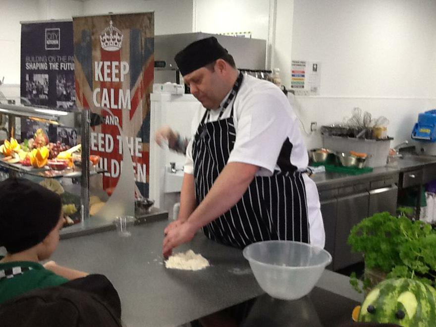 Chef Wayne mixed the pizza dough