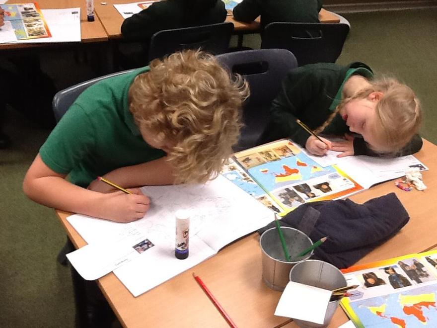 Using an atlas to locate continents