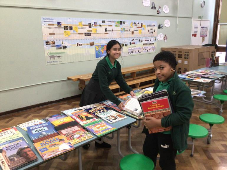Y6 Ambassadors prepared the hall ready for our sale.
