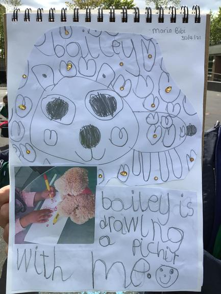 Maria in Reception chose to help Bailey to draw a picture.