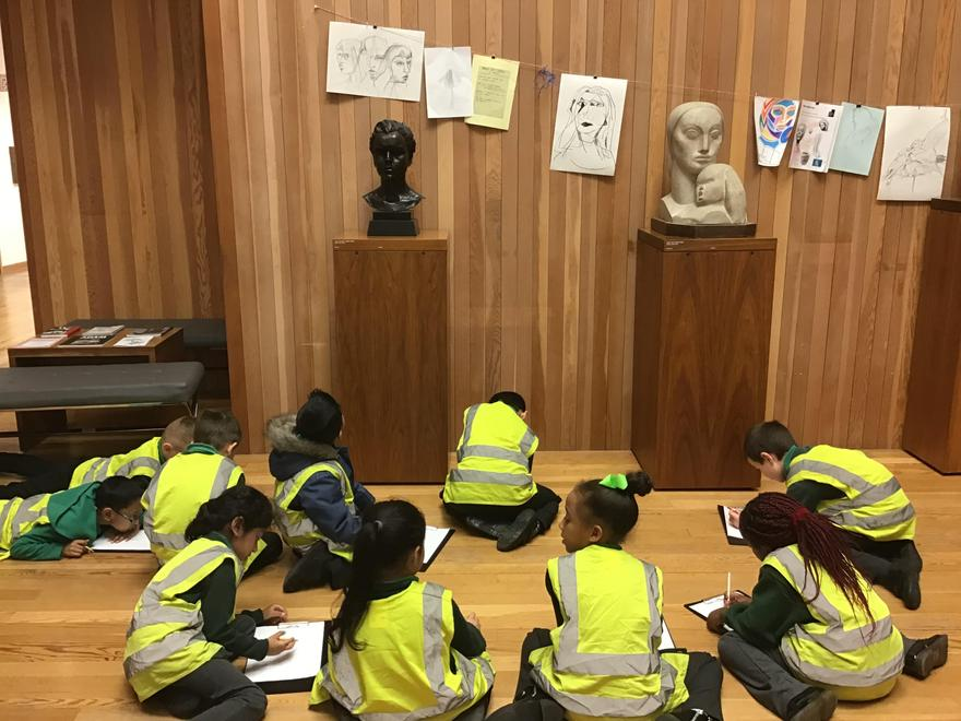 Drawing some of the sculptures in the gallery.