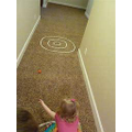 Use string or shoe laces to create a target for anything you have (ball, car, teddy!)