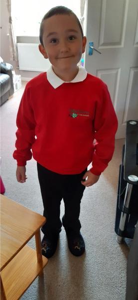 Proudly wearing his school uniform!