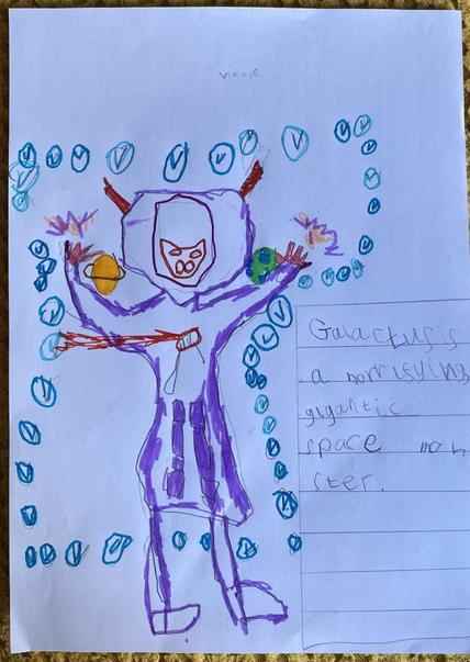 Vinnie drew a huge space monster and wrote a noun phrase to describe him.
