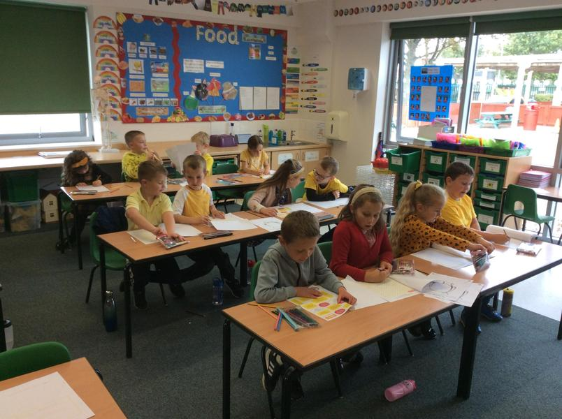 Completing our Hello Yellow workbooks