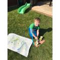 Leighton making a Jackson Pollack style painting.