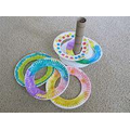 Make your own hoopla out of paper plates and toilet/ kitchen rolls!