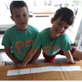 Archie and Charlie worked hard to solve the 15 cards Maths challenge.