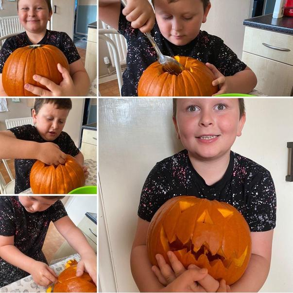 Vinnie carving a scary face into his pumpkin.