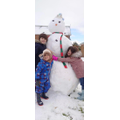 Alexia and her brothers built a MASSIVE snowman.