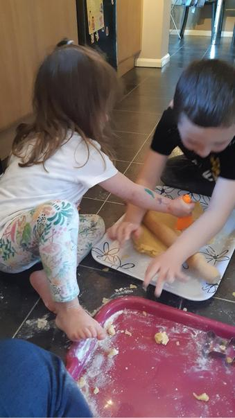 Baking biscuits with his sister!