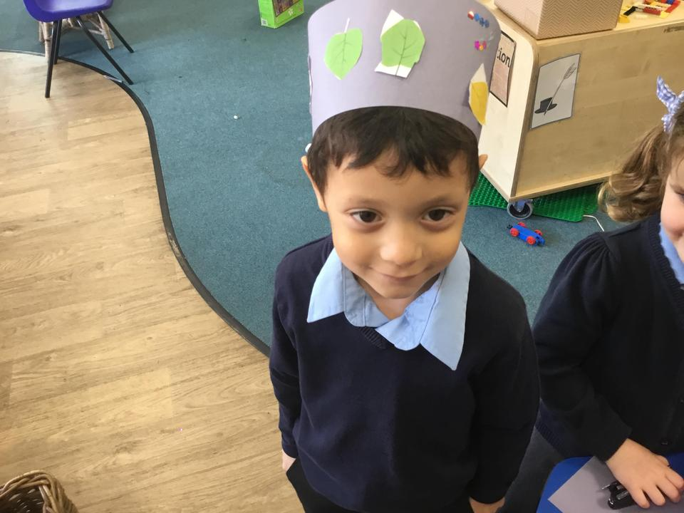 Practising our cutting and making leaf crowns