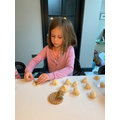 Isobel making salt dough fossils