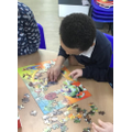 Busy completing a jigsaw