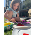 Isobel painting in the sunshine