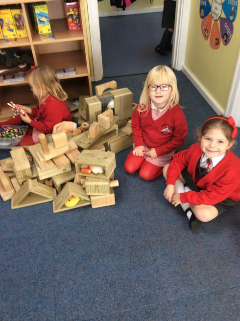 Esme and Hermione building an owl nest.
