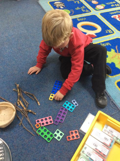 Using Numicon to pack the Owl's bags