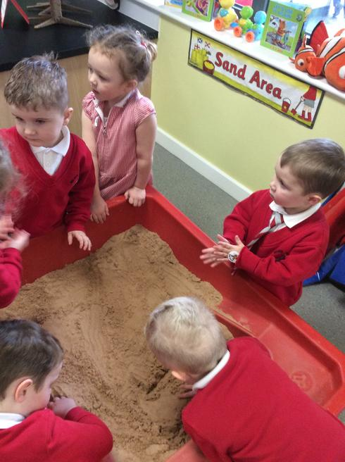 Writing 'e' for elephant in the sand!