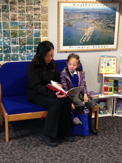 Sophia enjoying a book with mum before Buddies.