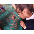 Painting our clay patchwork elephants were tricky!