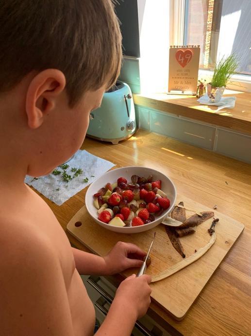Oliver making a fruit salad