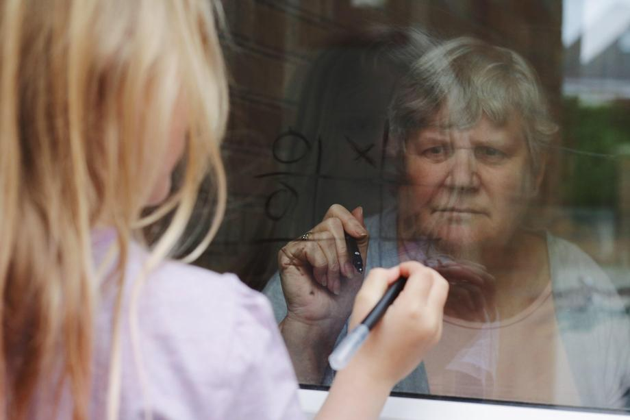 Freya playing noughts and crosses with her Grandma