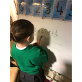 Practising letter formation and sounds.