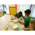 Decorating our gingerbread men.