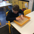 Exploring sand in a sensory story