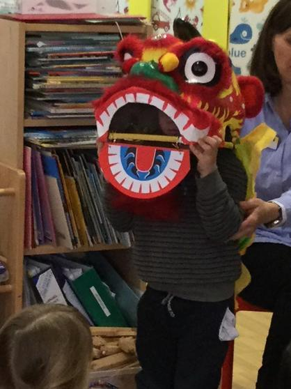 Here is Samuel wearing the lion headress!