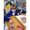 Threading beads through feathers