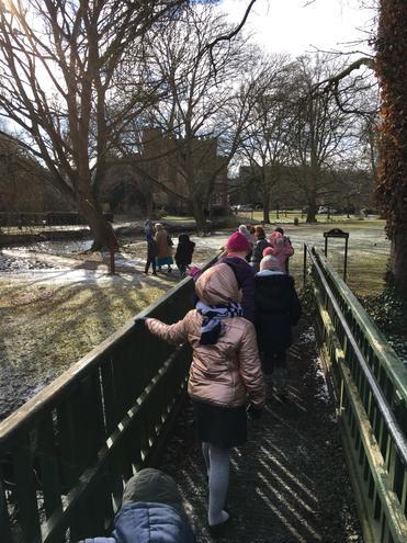 We crossed the bridge into the park.