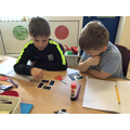 Using trial and improvement to find the secret number.