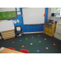 Here is our carpet area. You have a star or a spot to sit on!