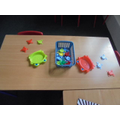 We have lots of activities that are fun and help to make our fingers strong.