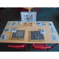 You can make pictures with the loose parts play.