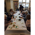 Acorn clas partnered up with an older adult and together they created leaf prints.