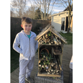 What a lovely smile! Your bug hotel looks amazing.