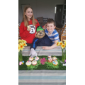Team Kilroe showcasing a lemon cupcake