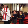 Leading the Baptism Service with Father John