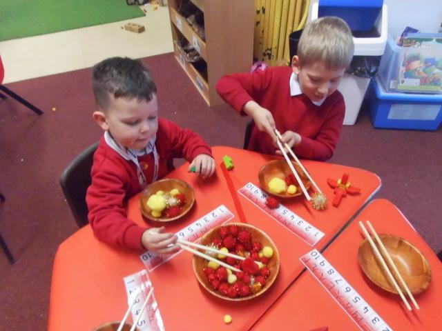 Trying our best to use chop sticks.