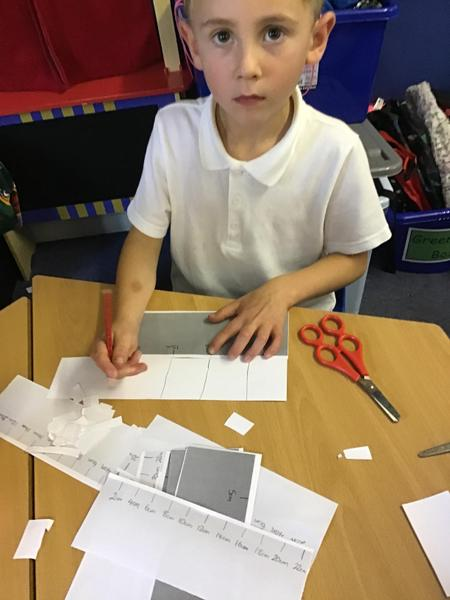 Measuring and cutting 2cm strips and 5cm strips