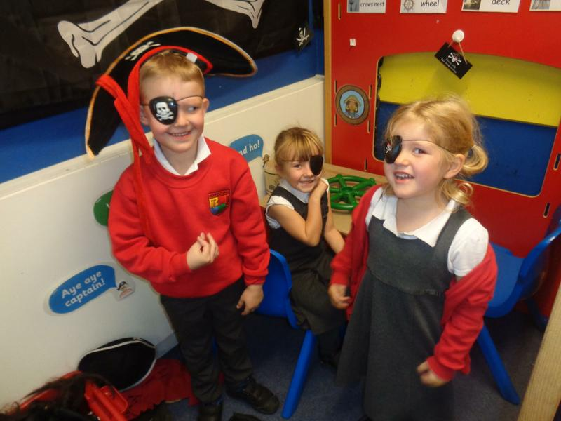 Acting out the story in the role play corner